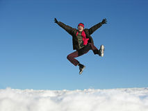 Fly jump man. winter. Blue sky stock photography