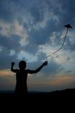 Fly a kite. Girl flying a kite Stock Photos
