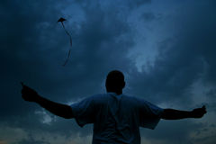 Fly a kite. Man flying a kite royalty free stock photo