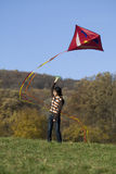 Fly a kite. Teenager in fall weather in nature Stock Photography