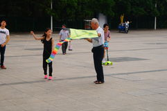 Fly a kite in the square Royalty Free Stock Photography