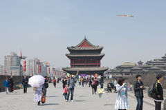 Fly a kite in Xian, China. People use the wall of Xian for a walk or let a kite fly royalty free stock photography