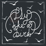 Fly like a bird. Hand-drawn lettering quote on the blackground. Stock Photo