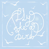 Fly like a bird. Hand-drawn lettering quote on the blue background. Stock Photos