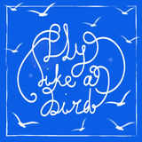 Fly like a bird. Hand-drawn lettering quote on the blue background. Royalty Free Stock Images