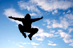 Fly man. Jumping man on a blue sky background Royalty Free Stock Photo