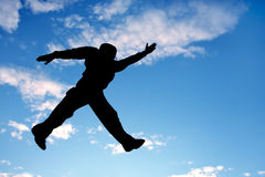 Fly man. Jumping man on a blue sky background Stock Images