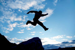 Fly man. Jumping man on a blue sky background Stock Photo