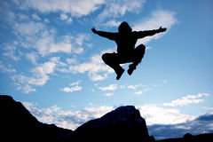 Fly man. Jumping man on a blue sky background Royalty Free Stock Image