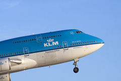 Fly in my boeing 747 on a blue sky. Stock Photos
