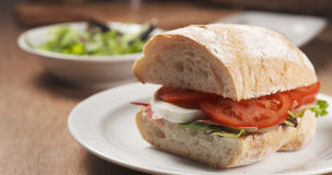 Fly out reveal ciabatta sandwich with speck, mazzarella and vegetables Royalty Free Stock Photos