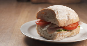 Fly out reveal ciabatta sandwich with speck, mazzarella and vegetables Stock Photo