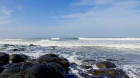 Fly over the ocean waves to the rocky beaches on the Bali Island. Fly over beach rocks Soka Bali. The waves from the sea go to black rocks beach on the paradise stock video footage