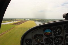 Fly over greenfield. Fly over rice filed in rural area Royalty Free Stock Image