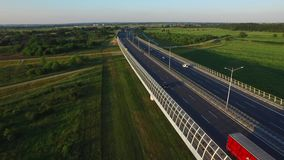 Fly over the highway in the sunset light stock video footage