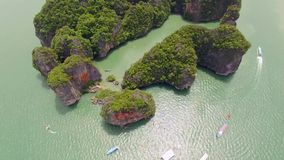 Fly over islands lagoon boat sea in Thailand stock video