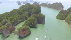 Fly over islands lagoon boat sea in Thailand stock video footage