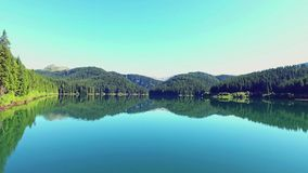 Fly Over Mirror Mountain Lake At Sunrise stock footage