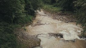 Fly over the mountain river after the rain.  stock footage