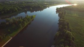 Fly over the river in the sunset light stock footage