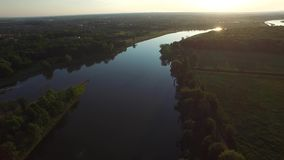 Fly over the river in the sunset light stock video footage
