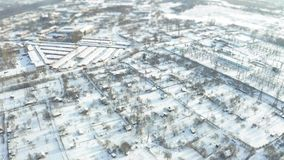 Fly over suburb near the electric power station. Tilt shift miniature stock footage