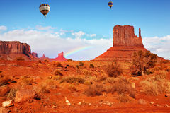 Fly over the valley huge balloons. Navajo Reservation in Arizona and Utah. Stone desert and rocks - mitts of red sandstone. Fly over the valley huge balloons Royalty Free Stock Photo