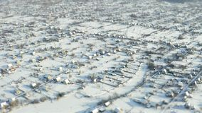Fly over winter suburb aerial survey tilt shift. Miniature stock video footage