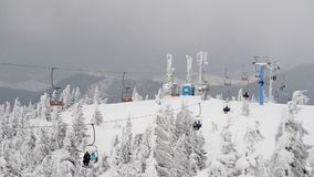 People on a ski lift, speed up stock video