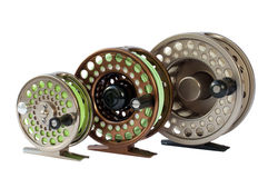 Fly Reels. Three fly reels of varying sizes for fly fishing Royalty Free Stock Image