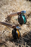 Fly rods in dry grass. Flyfishing - two rods lying in the grass stock images