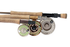 Fly Rods and Reels. Three fly rods and reels of varying sizes for fly fishing Stock Photo