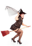 Fly-by of a sexy witch on a broom Stock Photos
