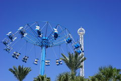 Fly through the sky. A high spinning swing ride with free swinging seats. As the ride begins to rise and spin, the seats swing outward. This ride is located on Royalty Free Stock Photo