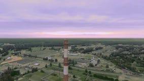 Fly smokestack on the horizon stock video