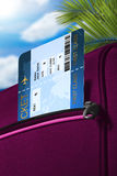 Fly ticket in pocket of rouge suitcase Stock Photos