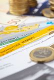 Fly tickets and money. Closeup Royalty Free Stock Photography