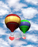 Fly together. Flying balloons on the sky background with hearts Royalty Free Stock Image