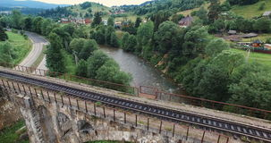 Fly under old arched bridge. Nature in the Carpathian mountains stock footage