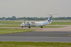 Flybe aircraft taxying. Flybe Dash 8, Q400 aircraft taxying for departure at Manchester airport Royalty Free Stock Image