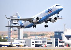Flybe airlines aircraft embraer ejet family Flybe E-195 takes flight speed and power in airport of alicante, spain Royalty Free Stock Photo