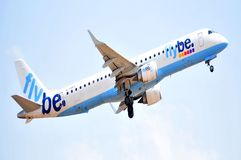 Flybe airlines power enginees in elevation maniobre to flight Royalty Free Stock Images