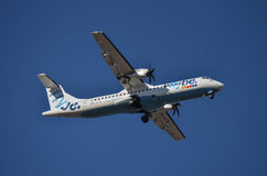 Flybe ATR-72. Approaches Helsinki-Vantaa Airport Royalty Free Stock Photo