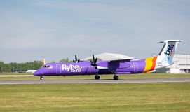 Flybe Bombardier Dash 8 Q400 preparing to take off at Manchester Airport Royalty Free Stock Images