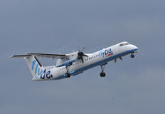 Flybe Dash 8. Taking off at Manchester Airport royalty free stock image