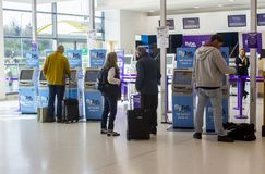 Flybe self check in desks at Belfast City Airport in Northern Ir royalty free stock photography