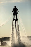 Flyboad. The flyboard flies over the water Stock Photo