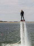 Flyboard Aerobatics. Flyboard by JetSki FreeStyle Team during aerobatics at AeroNautic Show 2013 - Morii Lake, Bucharest stock photos