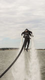Flyboard Aerobatics. Flyboard by JetSki FreeStyle Team during aerobatics at AeroNautic Show 2013 - Morii Lake, Bucharest stock image