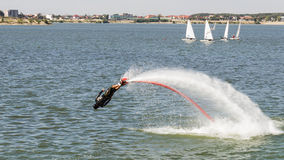 Flyboard Aerobatics. Flyboard by JetSki FreeStyle Team during aerobatics at AeroNautic Show 2013 - Morii Lake, Bucharest royalty free stock photography